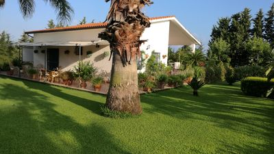 Photo for Villa in the countryside surrounded by a lush lawn at 2 Km from the sea