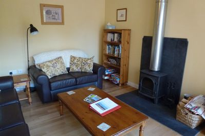 Open plan sitting room with woodburner