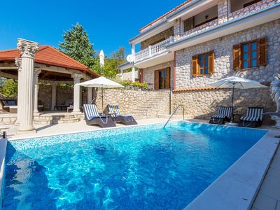 Photo for Holiday apartment with an outdoor pool and sea views