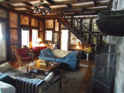 This is the 'great room' - 12 foot fireplace, wood floors, birch walls.