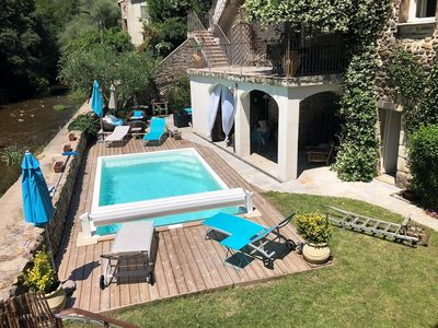 Photo for Cottages in the Cévennes, with swimming pool, along the river and forest