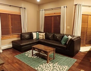Large leather sectional with queen size sleeper sofa.