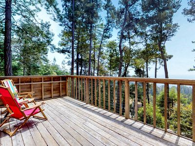 Photo for Historic cabin w/ woodstove, deck with ocean views, and shared pools/tennis!