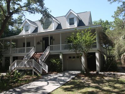 Photo for One row off beach, on golf course, Updated, designer and Gourmet - sleeps 8!!