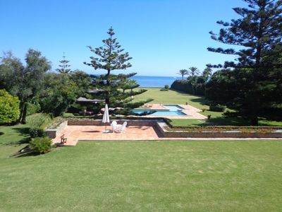 Photo for BEACHFRONT HOLIDAY VILLA , PRIVATE TENNIS COURT ,10 000 M2 GARDENS , HEATED POOL