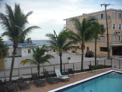 Photo for VIEW OF THE BEACH AND BOARDWAlLK FROM THE HEATED  POOL FREE PARKING WIFI HBO