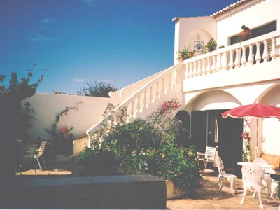 Photo for An elegant villa and cottage with gardens and pool in a truly unspoilt village.