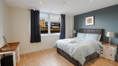 Photo for Harbour View Suites (B). Water view, 3 bedroom apartment. Sleeps 6. Parking nearby.
