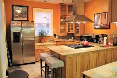 Super Nice Chef's  Kitchen fully equipped for creating and serving meals.