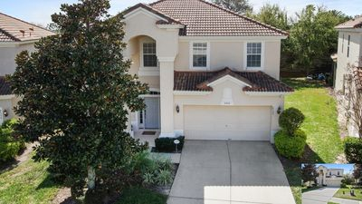 Photo for Mickey's Waiting for You minutes from Disney in this 6 bedroom home with pool!