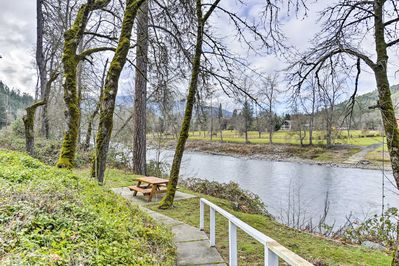 Escape to the bliss of nature at this waterfront home nestled near Rogue River.