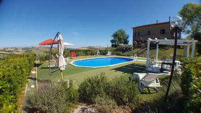 Photo for Comfortable villa with private pool near the sea in the Marche countryside