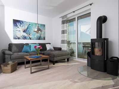 Photo for Modern holiday home in direct water location with fantastic water view - Three terraces - 360 ° roof terrace - Private wellness area - Stylish decor - High-quality equipment - Wood-burning stove - Near the beach