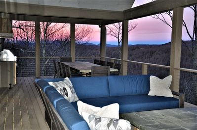 Gorgeous Sunset on Main Floor Deck with L-Shape Sectional and 10-seat Tin Table.