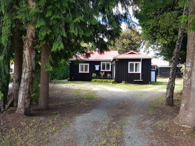 Photo for Cute Kiwi Woodland Cottage nestled amongst trees and 5 minutes from town