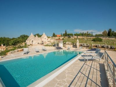 Photo for Magnificent trulli with swimming pool, located in the enchanting greenery of Barsento