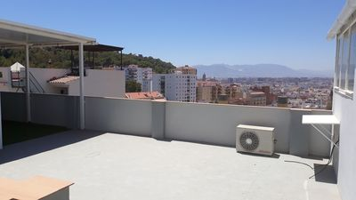 Photo for Enjoy your stay in Malaga, views from terrace in quiet and well located place