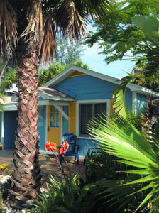 Photo for Gorgeous cottage with private decks, Grill and free Wifi just steps to the beach