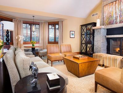 Relax and unwind with a movie or in front of the fireplace in the spacious living area.