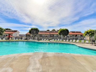 Photo for New Listing! Cozy condo w/ shared pool & hot tub - walk to beach & park