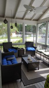 Screened-in front porch is the perfect place for enjoying your morning coffee.