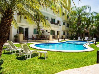 Photo for Deluxe Oversized Poolside Condo Located close to 5th Avenue & Beach