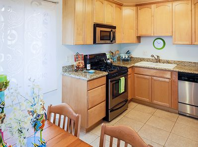 Fully equipped kitchen with green aqua accents.