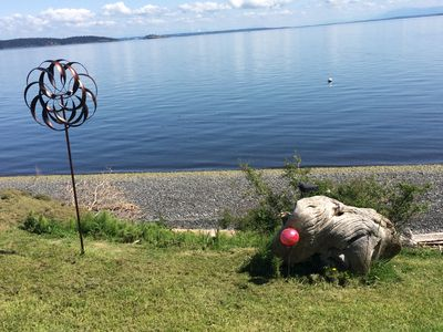 As you come down our driveway, the beach & our yard art are out to welcome you!