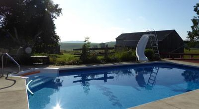 Heated outdoor pool overlooking the rolling landscape