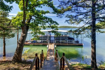 Boat dock with Covered slips, swim deck...just steps from the cabin!