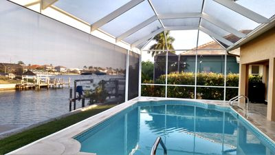 Photo for 'Caribbean Home' Large heated pool. Panoramic views of the Waterway!