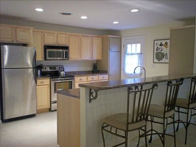 Kitchen with Bar Seating for 4.  Now Fully Opens to Spacious Dining and Living.