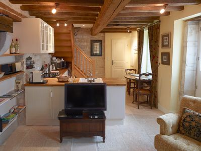 Open plan lounge/dining/kitchen, TV with English and French channels