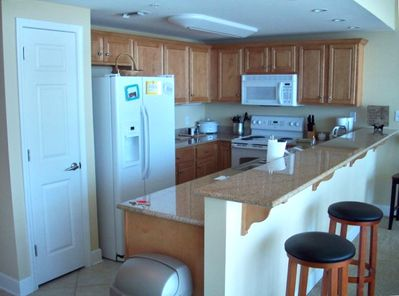Kitchen with granite countertops and new appliances