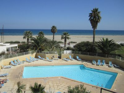 Photo for Canet-beach F3 seafront, terrace, pool. New: parking space