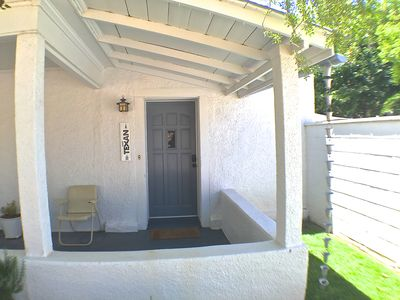 Front entry w/ lush lawn and covered porch. Sit & watch the action on Texas St!