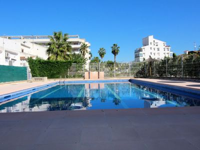 Photo for Semi-detached house very well equipped with Air Conditioning, communal pool and parking