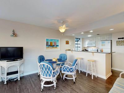 Photo for Renovated beachside condo with two shared pools, hot tub, sauna & prime location