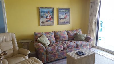 Sleeper sofa in Living Area...snuggle up on the couch, watch TV and see the Gulf