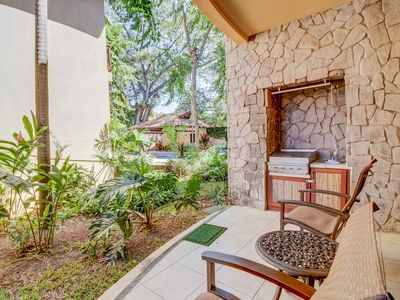 Photo for Condo with shared pool, patio & jungle landscaping - walk to the beach!