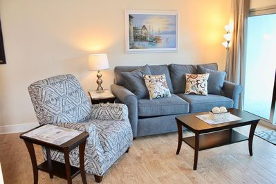 Living room features sleeper sofa & comfy chair