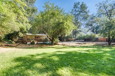 Sunny, gated and fenced 1/2 acre parcel right in the heart of downtown Murphys