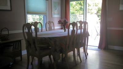 Comfortable Dining table next to sliding glass doors to large deck