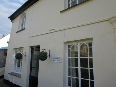 Photo for Old Fisherman's cottage ideally situated directly opposite Combe Martin beach