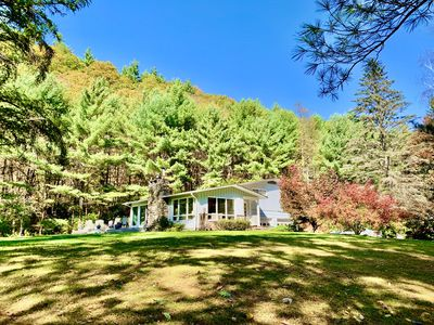 Beautiful house on 6 private acres, surrounded by trees...