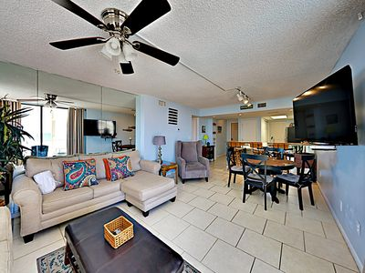 """Living Room - Unwind in a bright living area with sleeper sofa and a 55"""" flat screen TV."""