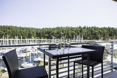 Enjoy ocean & marina views with a beverage or two on the balcony! Seating for 6.