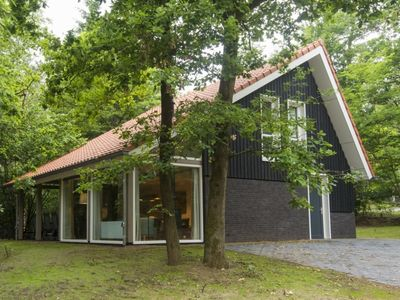 Photo for 8-person bungalow in the holiday park Landal Miggelenberg - in the woods/woodland setting
