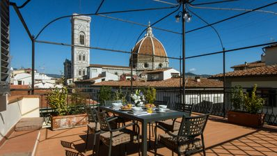 Photo for Supreme penthouse with unique patio in the heart of Florence.