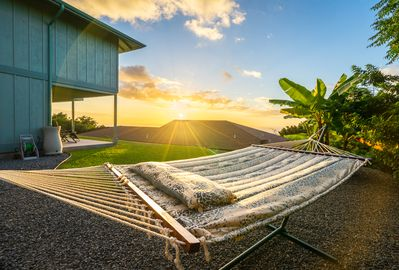 Enjoy the sunset from a 2-person hammock in the backyard.